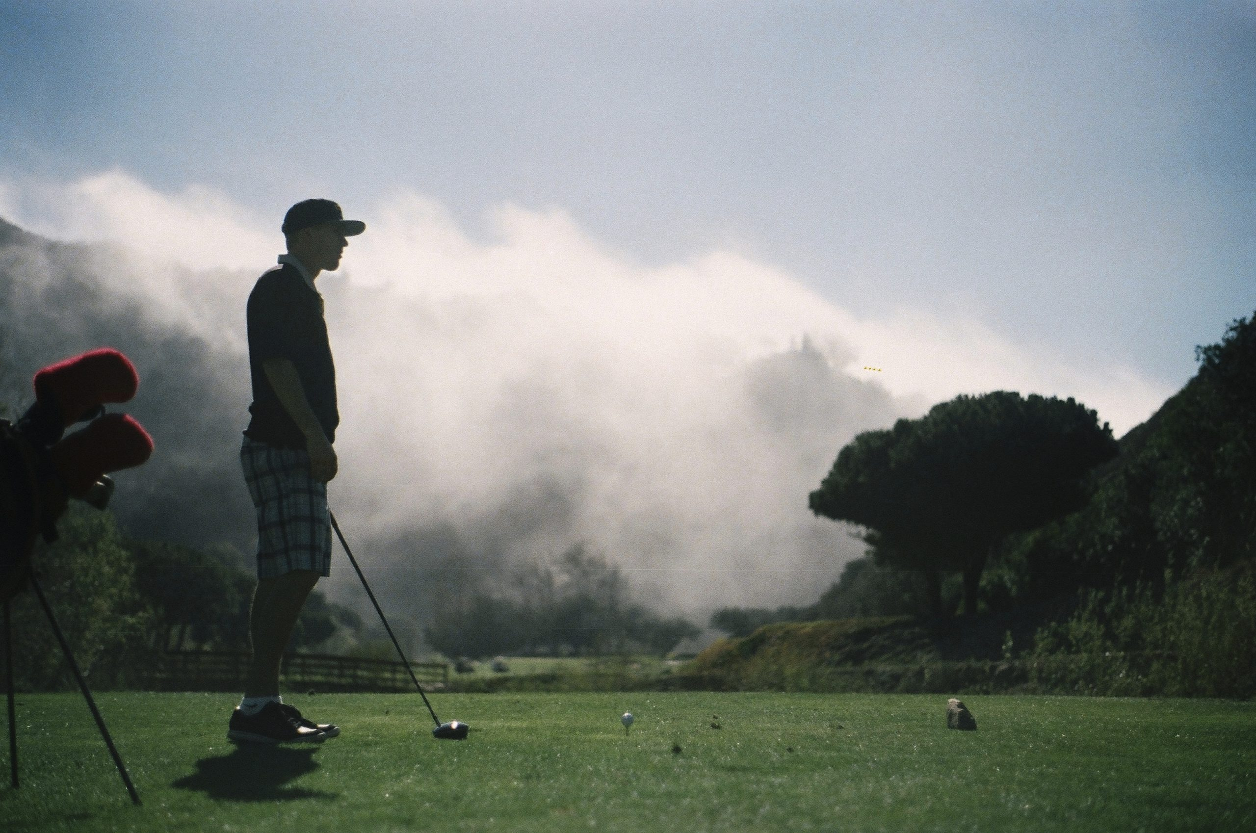 man playing golf in fog