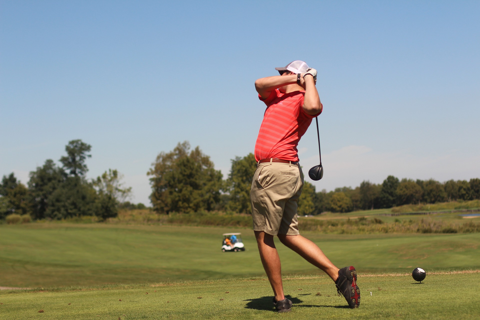 Man teeing off at a golf course